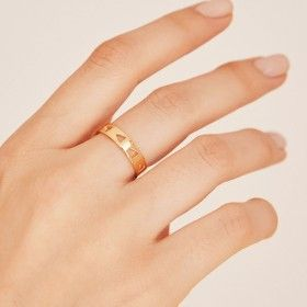 Follow gold ring hand 1