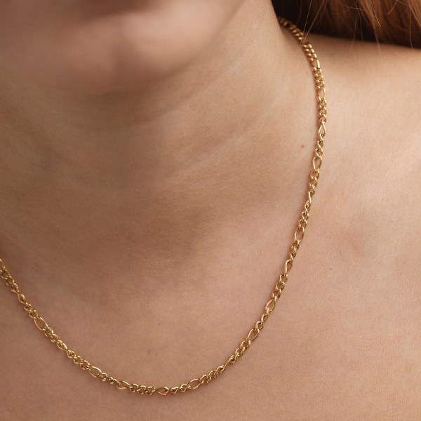 Gold figaro chain necklace detail