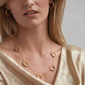 gold necklace and earrings set detail